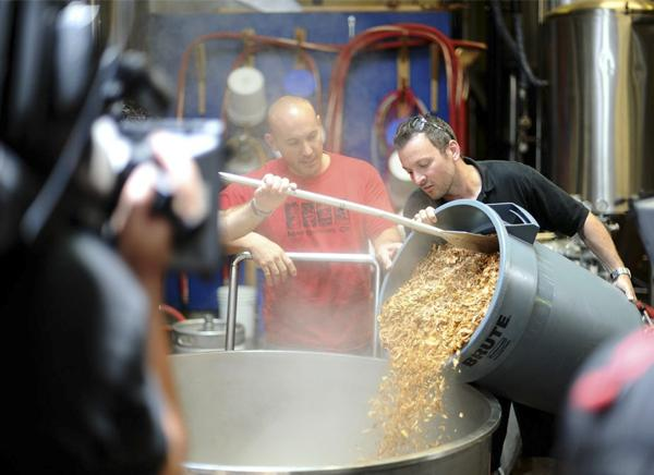 Brewers prepare the ingredients for one of Maui Brewing Co.'s beers at its production facility in Lahaina. Owners plan to build a much larger plant in Kihei that could open within a year.