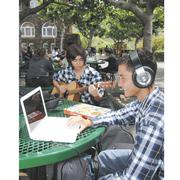 Mid-Pacific Institute sophomores Matt Okimura, left, and Philip Kitamura take a break between classes. Higher tuitions are putting pressure on parents who opt to send their children to Hawaii's private schools.