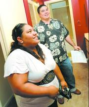 Kaleo McCabe, right, a property manager for Rental Solutions, shows Venus Seda a home in Kapolei. Seda is wanting to get a bigger rental for her family.