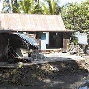 Tsunami damage to Fair Wind's main building at Keauhou Bay.