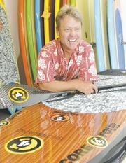 Todd Bradley says his company's name is based on the 'core four' values of the Hawaiian waterman culture: balance, endurance, strength and tradition.