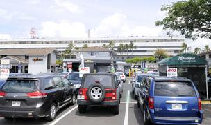 Car rental companies share outdoor space near Honolulu International Airport. New facilities are planned for the Honolulu and Kahului, Maui, airports.