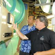 """Dante Bumanglag, left, and Alan Tepping monitor a chiller at Pacific Guardian Center in downtown Honolulu. PGC is among the office buildings that are finding """"green"""" answers to rising energy costs."""