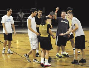Attorney Scott Suzuki, far right, volunteers his time coaching players in Special Olympics as the head basketball coach at Holy Nativity, something he has been doing for almost 11 years.