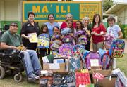 D.R. Horton – Schuler Division supports Community Helping Schools in a variety of ways. Here, the company is delivering school supplies to Maili Elementary School.
