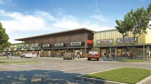 An architect's rendering provides a preview of what the Kapalama Shopping Center in Kalihi will look like when renovations are completed next year.