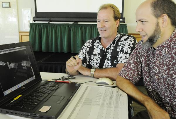 Rod McLaughlin, left, director of project development for dck pacific construction, and John Vann, project architect for RIM Architects, review a $46.6 million project for Marine Corps Base Hawaii.