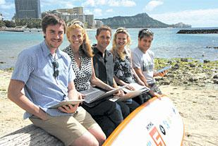 Part of the Ocupop team gathers on the beach. From left are Matt McVickar, art director and front-end engineer; Dayna Even, marketing and public relations; Cory Shaw, usability, design and Internet marketing engineer; Julie Ford, marketing and public relations collaborator; and client Tom Noel from Hawaiian Ocean Adventures.