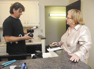 "Art Anders, a remodeling consultant, works with Re/Max Realtor Cori Hamilton to prepare a  property for sale at the Village Maluhia condominiums in Makiki. ""In my mind, the prep is everything,"" Hamilton says."