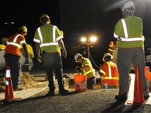 Archaeologists are seen working at night on the survey trenches for the Honolulu rail transit project in Kakaako. The Honolulu Authority for Rapid Transportation says it expects to complete the trench work on Sunday.