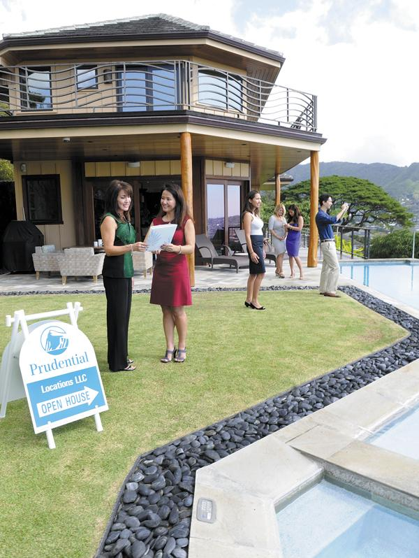 Prudential Locations Realtors Susan Onishi, left, and Bonnie Ishii Coen review fact sheets for a $2.75 million Manoa property at a brokers open house. Local real estate executives predict that housing prices will increase in 2013.