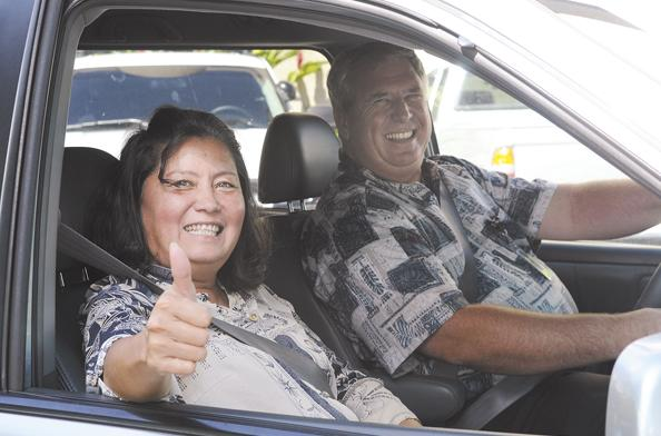 George Butler and Cheryl Morton buckle up for the ride home to Mililani from the Federal Building in Downtown Honolulu. When Vanpool Hawaii no longer made economic sense, Butler created his own company, Butlers in Paradise LLC.