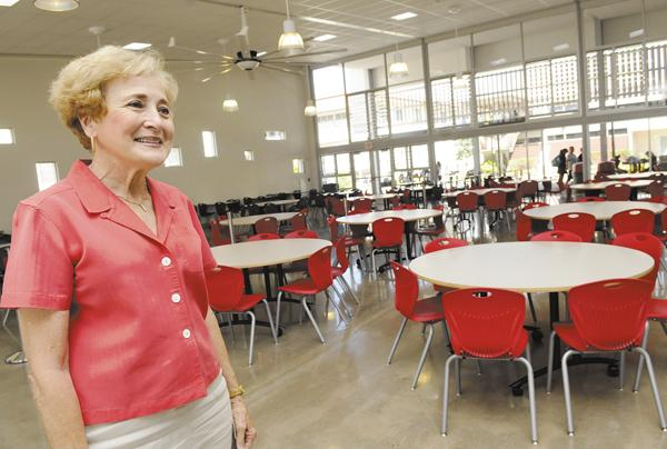 Sacred Hearts Academy Head of School Betty White checks out the new $6.2 million student center, which she says is both a cafeteria and a gathering place for students to study together before and after school.