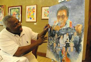 Artist John Nichols puts the finishing touches on a painting that features several of Hawaii's legendary jazz musicians. Posters from the painting will be used to raise funds for a film based on the life of singer Jimmy Borges.