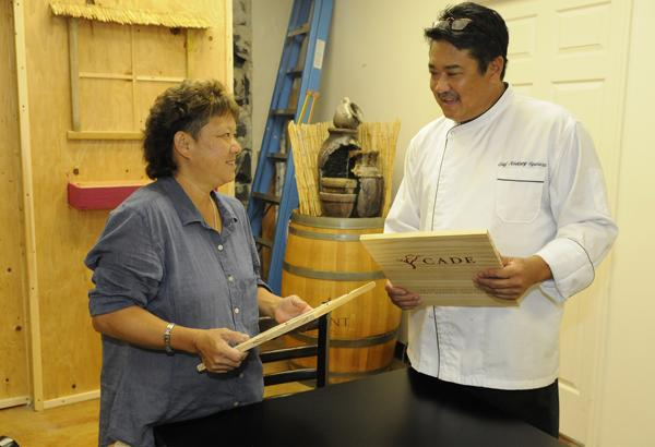 Terry Kakazu, owner of HASR Bistro and HASR Wine Co., goes over menu items with Chef Rodney Uyehara in the back room of the Chinatown restaurant, previously home to the Grand Cafe. Uyehara, who previously worked at The Bistro at Century Center and  the Beach House at the Moana Surfrider, will help Kakazu turn the room into a Hawaii version of the famous French Laundry restaurant in Napa Valley, Calif.