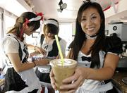 Ema Saranillio, right, prepares a double espresso on ice with milk at the Mobile Maid Cafe, which she and her husband, Justin, opened Nov. 1.  Based on a Japanese concept, the food truck features women dressed as maids who serve their customers. Preparing baked goods are Yoshimi Guillemot, left,  and Jessica Guerrero.