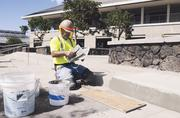 Dan Laukala, a cement mason for General Contractor Albert C. Kobayashi, puts the finishing touches on the walkway fronting the student services building at the University of Hawaii's new West Oahu campus in Kapolei.