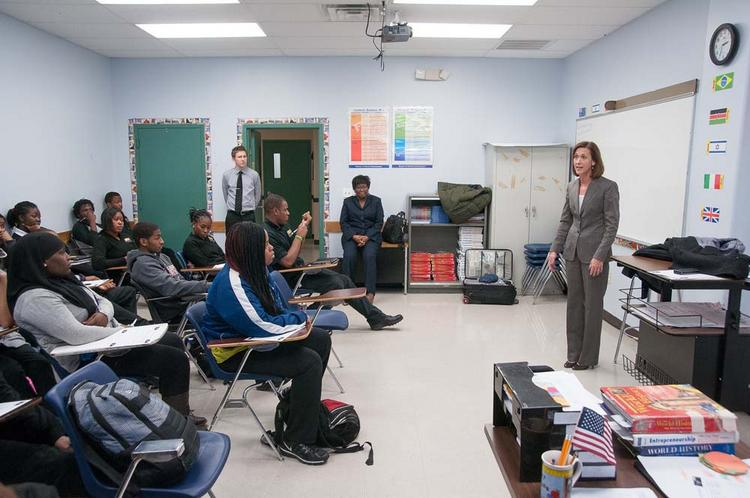 Annemarie Furdella, Bank of America business banking development officer, talks with students in a Network For Teaching Entrepreneurship class at World Communications Charter School. Bank of America recently gave NFTE a grant to support the expansion of the program.