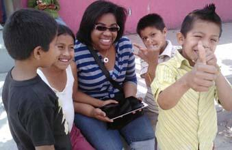 Rushelle Mundell of Hopeworks 'N Camden has fun fooling around with her new Mexican friends.
