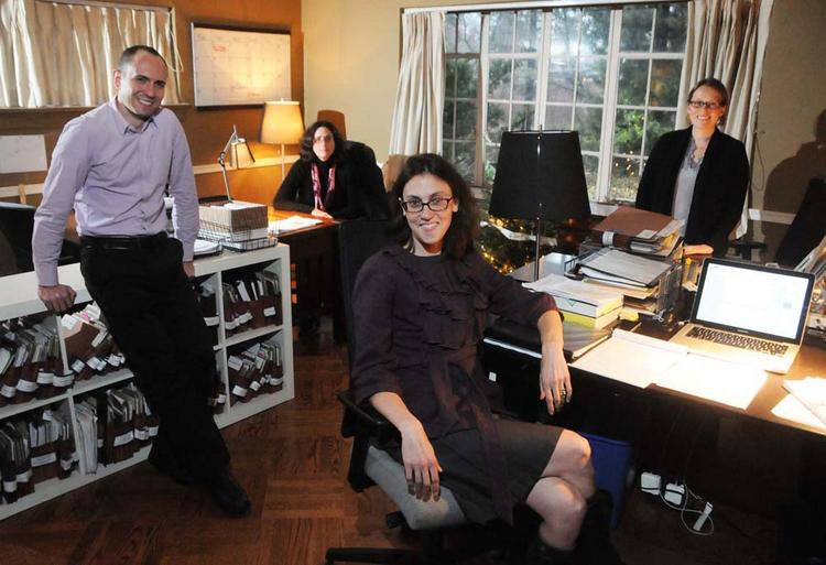 Morgen Cheshire (center) in her home office, a converted family room, with associates John Kuehne, Beth Dougherty and Kate Williams (right).