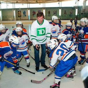 Hockey legend Wayne Gretzky dropped the first puck at a youth hockey pickup game Monday on Coney Island, N.Y., as part of his job as TD Bank ambassador that led him to Philadelphia that night.