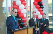 Jim Eisen, president of Visionworks, addresses the crowd at Friday's South Philadelphia store opening as Richard J. Neeson (center), an IBC executive vice president, and HVHC Inc. CEO David Holmberg look on.