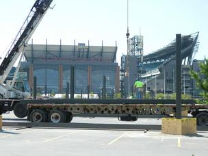 Workers installing pylons for solar panels outside Lincoln Financial Field, home of the Philadelphia Eagles.