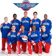 The Sixers Flight Squad dunk team.