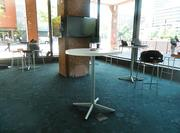 The innovation center has tables referred to as pods where customers can sit and try out the company's equipment.