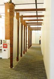 A wooden trellis was created to separate the sales area. The wood complements the brick.
