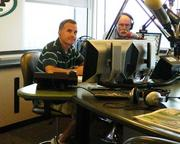 Rob Ellis (left), who typically works an evening show, and Jody MacDonald, filling in for the vacationing Michael Barkann and Ike Reese one recent morning.