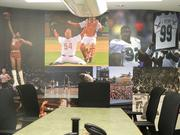A collage of photos from some of Philadelphia's most famous sports moments cover a wall in the conference room.