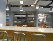 The cafeteria, which also serves as a space where the company can hold a town hall meeting.