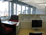 The digital media center on the first floor. A print room with oversize printers is behind it.
