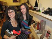 On a stretch of South 4th Street traditionally known as Fabric Row, newcomers include Bus Stop Boutique (727 S. 4th), a high-end shoe store. Here owner Elena Brennan (left) and manager Aubrie Costello show some of the store's merchandise.