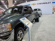Of course, car shows are all about extremes. So, after looking at some compacts and hybrids, you might want to check out a Chevy Silverado 3500 with crew-cab, four-wheel-drive, turbo diesel and dual wheels (for towing big loads). This one sells for $62,000.