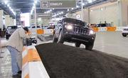 Jeep offers indoor driving tests on an obstacle course. Here a Jeep Grand Cherokee tests its mettle on a steep bank.
