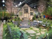 A rustic greenhouse is part of an English garden designed by Hunter Hayes Landscape Design of Ardmore, Pa.