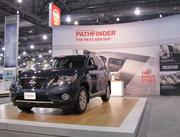A display of the Nissan Pathfinder, a considerably larger model than the one introduced in 1986. New Pathfinders range from $28,300 to $40,770.