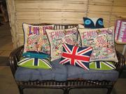 English needlepoint pillows, including one bearing the Union Jack, are for sale in the PHS Shop.