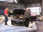 Workers prepare a Mercedes E350 Cabriolet, which is listed at $66,845.