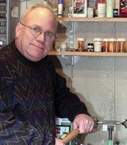 """The artisan at his work station. Now removed from it, Alan Shaw says the business world is """"crazy."""""""
