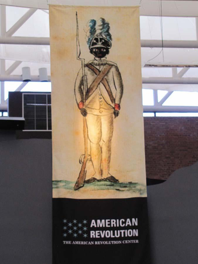 A poster promoting the museum was on display at the press conference Tuesday.