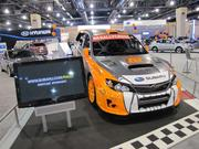 "Subaru has long had a presence on the Rallycross circuit. A WRX STI driven by team driver Bucky Lasek is on view at this year's Philadelphia Auto Show. Before becoming a professional racecar driver, Lasek was a pro skateboarder, medaling in the ""vert"" competition 10 times at the X Games."