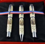 These pens by Shaw include a portrait of President John Adams.