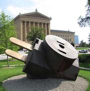 "Claes Oldenburg's ""Giant Three-Way Plug"" outside the Philadelphia Museum of Art."