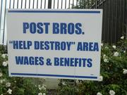 Anti-Post Brothers signs near the project
