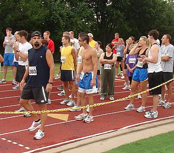 Runners at a starting line.