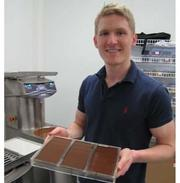 """Fabian Kaempfer, the 24-year-old managing partner of Chocomize. The Cherry Hill company offers customized chocolate bars — with any topping the customer chooses, with personalized messages of """"Happy Birthday"""" or even """"Will you marry me?"""""""