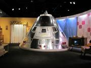 The exhibit includes a replica of the Apollo 8 capsule, the second manned mission in the Apollo program.